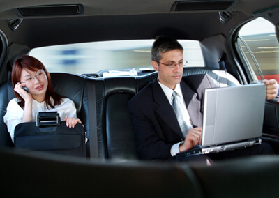 Business people in chauffeured car