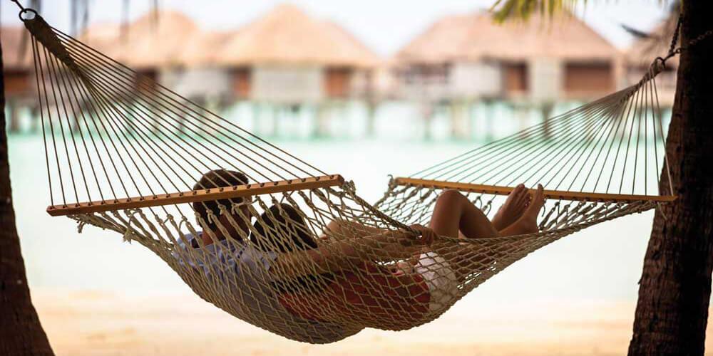 Honeymoon couple lying on the hammock