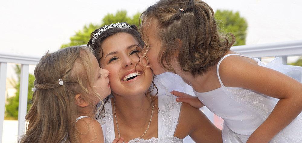 Bridesmaids kissing the Bride